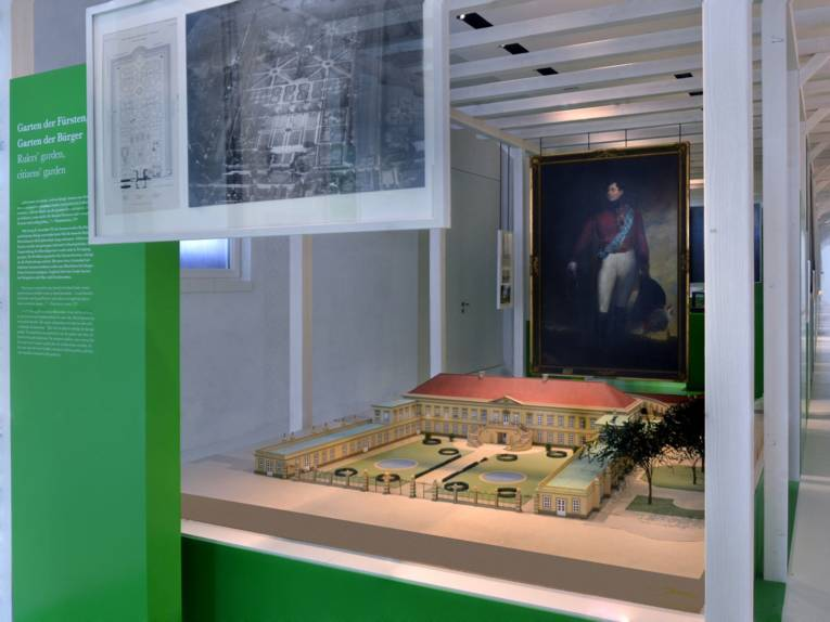 A view of the garden wing in Herrenhausen Palace Museum: a model of the Palace from earlier times is placed in the centre of the picture, in the background there is a large-sized painting