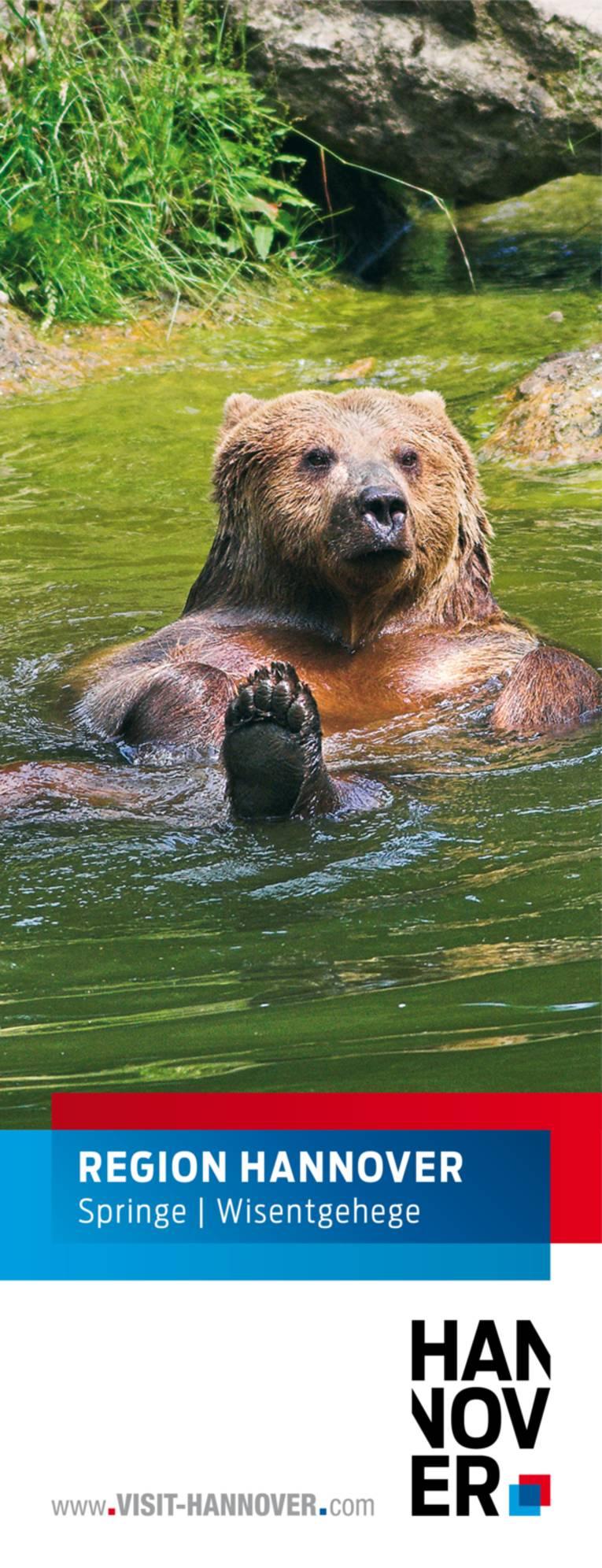 Springe präsentiert sich mit dem Foto eines Bären im Wisentgehege.