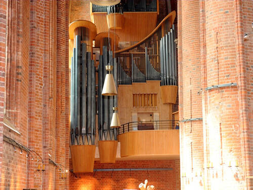 An large organ in a brick church.
