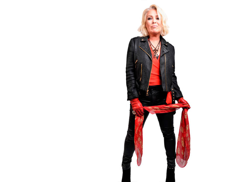 A blonde woman dressed in black and red.