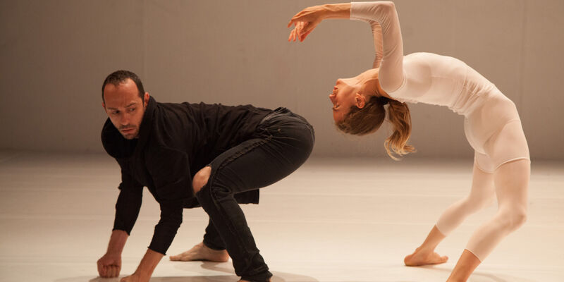 Man and woman in dance-acrobatic pose